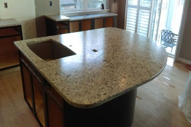 Bianco santa cecilia granite with leathered finish and double radius edges 597